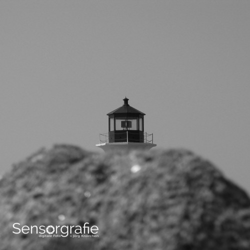 Punkt: Die Perspektive macht die Leuchtturmspitze zum Punkt Motiv